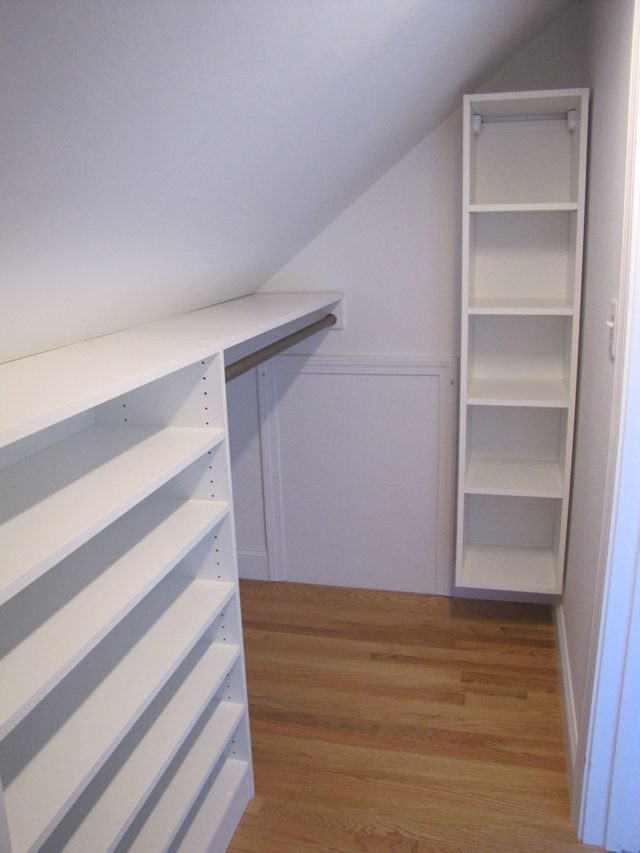 White Narrow Walk-In With Access Panel Slanted Ceiling