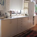 Antique white cabinetry custom built for an artist