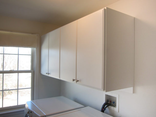 Closed Cabinetry In White With Classic Doors
