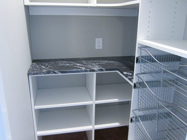 White Pantry With Granite Counter Baskets