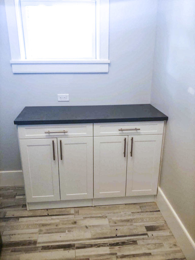 Folding Area With White Shaker Cabinets
