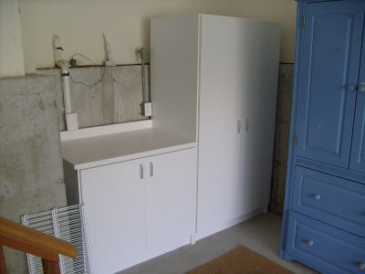 Garage Cabinet and Workbench - White extra-deep cabinet and workbench with plenty of shelving storage in both cabinets.