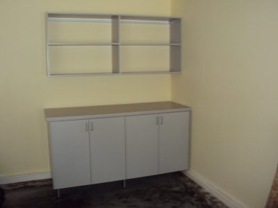 Garage Workbench - Gray workbench with shelving behind doors and Formica counter-top for all your do-it-yourself projects