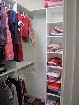 Child's Walk-in Closet - High and low hanging racks plus ample shelving and storage options.
