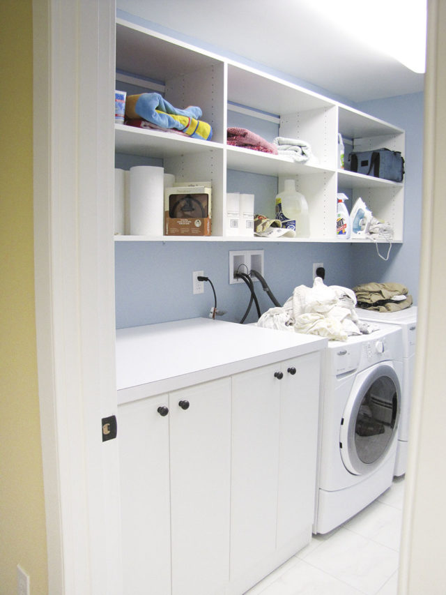 Laundry Room With Lots Of Shelving And Folding Space