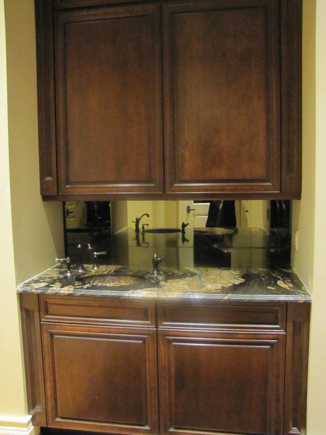 Mahogany Stained Wood Cabinetry And Bar