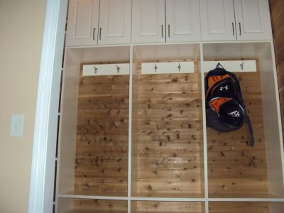 Mudroom cubbies with hook boards and storage cabinets