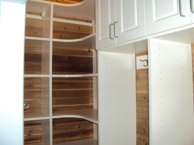 Mudroom cubbies with radial shelving and cabinets