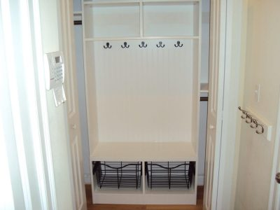 Entry closet with cubby baskets and hooks