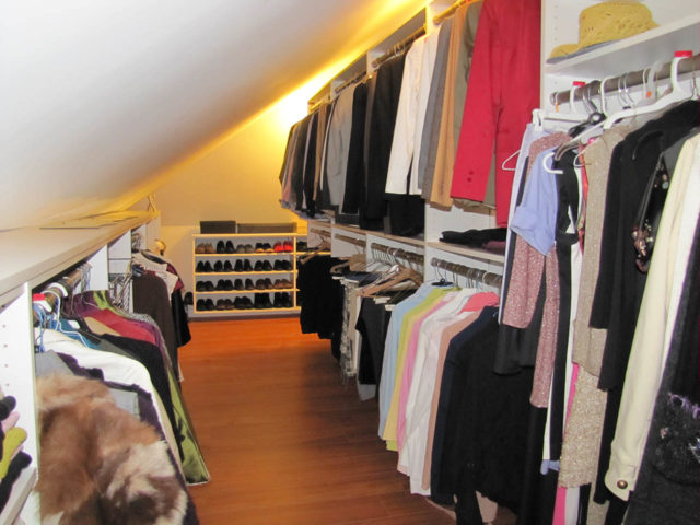 White Closet With Slanted Ceiling